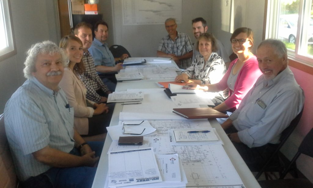 Construction start-up meeting, July 28, 2016. From left: Karl Falk (DSI Tandem), Heather Stevenson (Manitoba Housing), Marc Bourrier (Concord Projects), Pierre Laurin (Concord Projects). Rene Maillot (Concord Projects). Jared Lloyd (CKP Engineering) Sandra Hardy (OGHC), Lindsay Oster (Prairie Architects), and Harry Haid (DSI Tandem.) Missing Victor Dobchuk and Laura Sevenhuysen (both with OGHC). Photo credit: Victor Dobchuk.